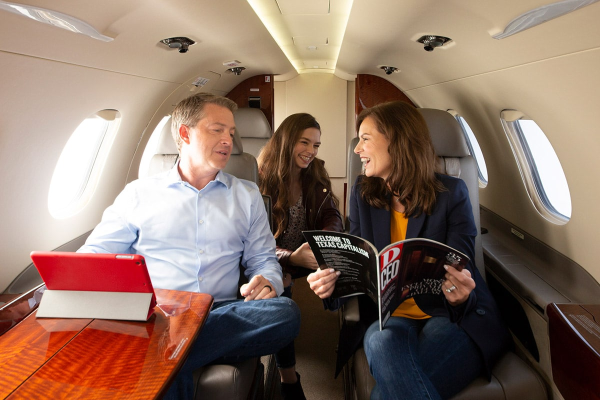 Family enjoying fractional ownership on the Phenom 300 private jet.