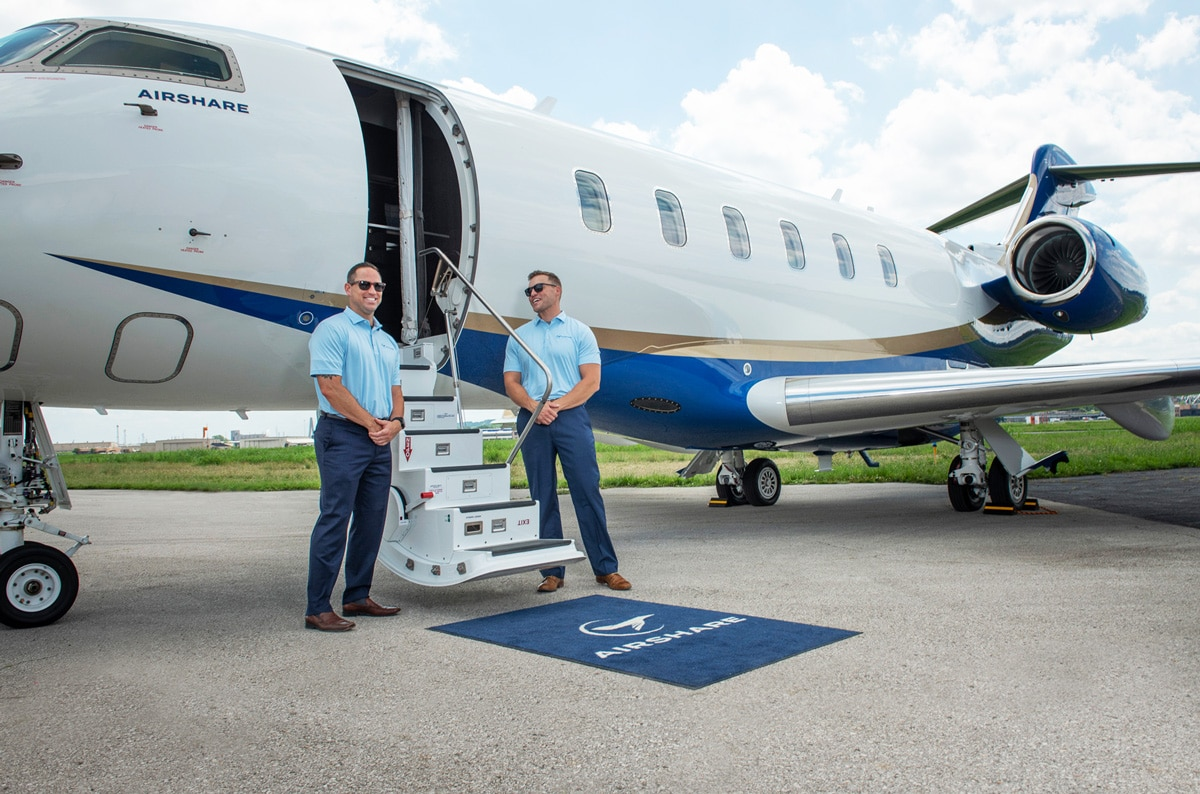 Airshare Pilots Standing Next to Challenger 350